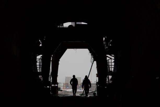 The silhouette of two people in a high-speed railway tunnel under construction stock photo