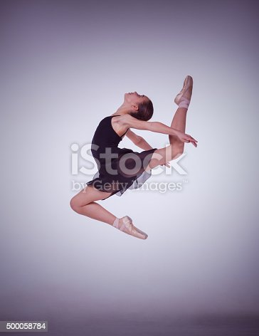 476021886 istock photo The silhouette of young ballet dancer jumping on a lilac 500058784