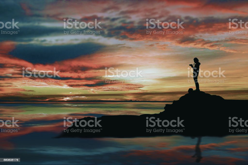 The silhouette teenage girl taking photograph, when sunny down. royalty-free stock photo