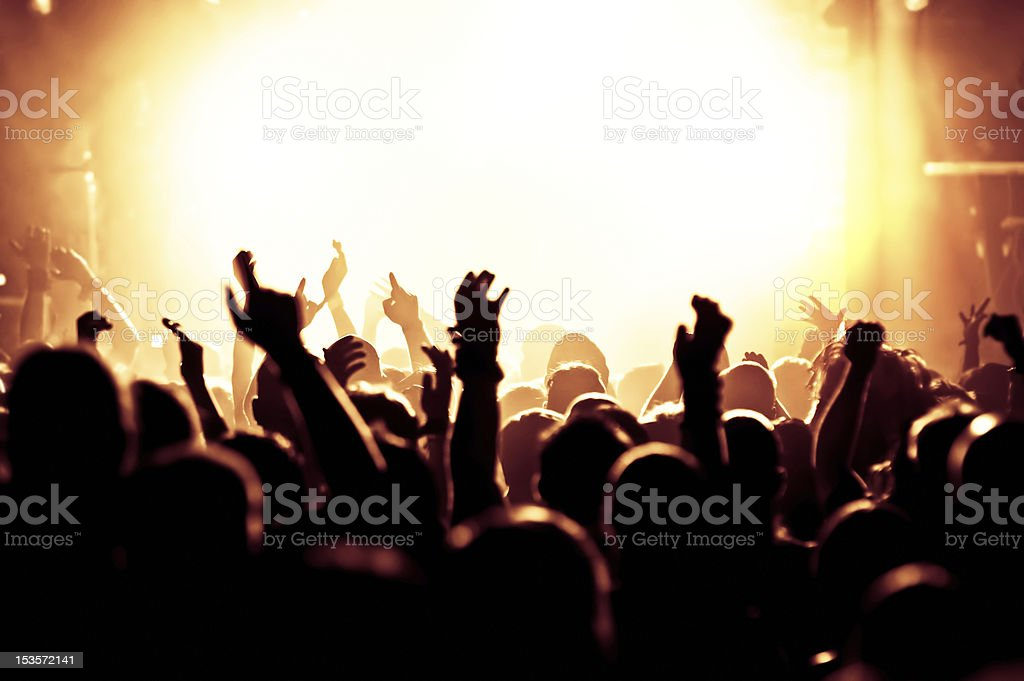 The silhouettes of a large crowd at a concert royalty-free stock photo