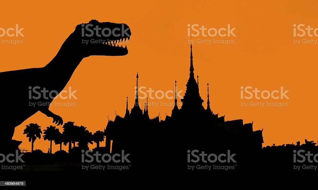 the silhouettes of dinosaurs in temple stock photo