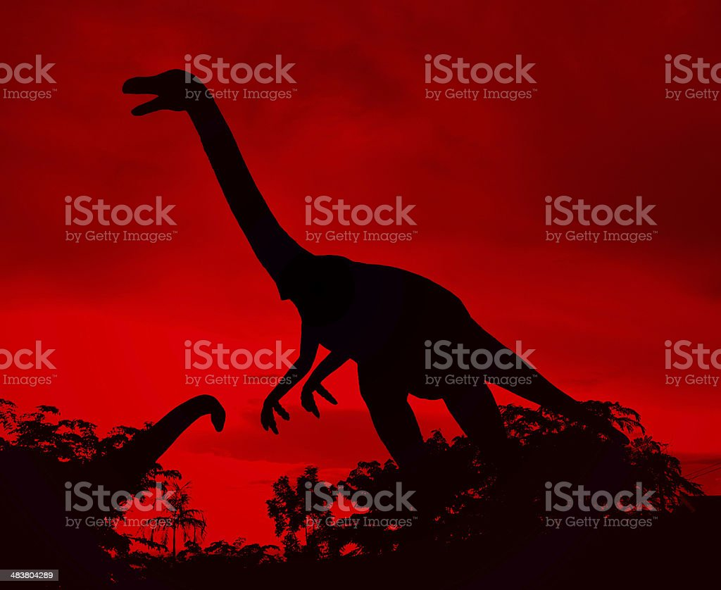 the silhouettes of dinosaurs stock photo