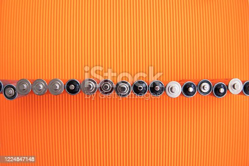 istock The silver aa batteries on an orange background 1224847148