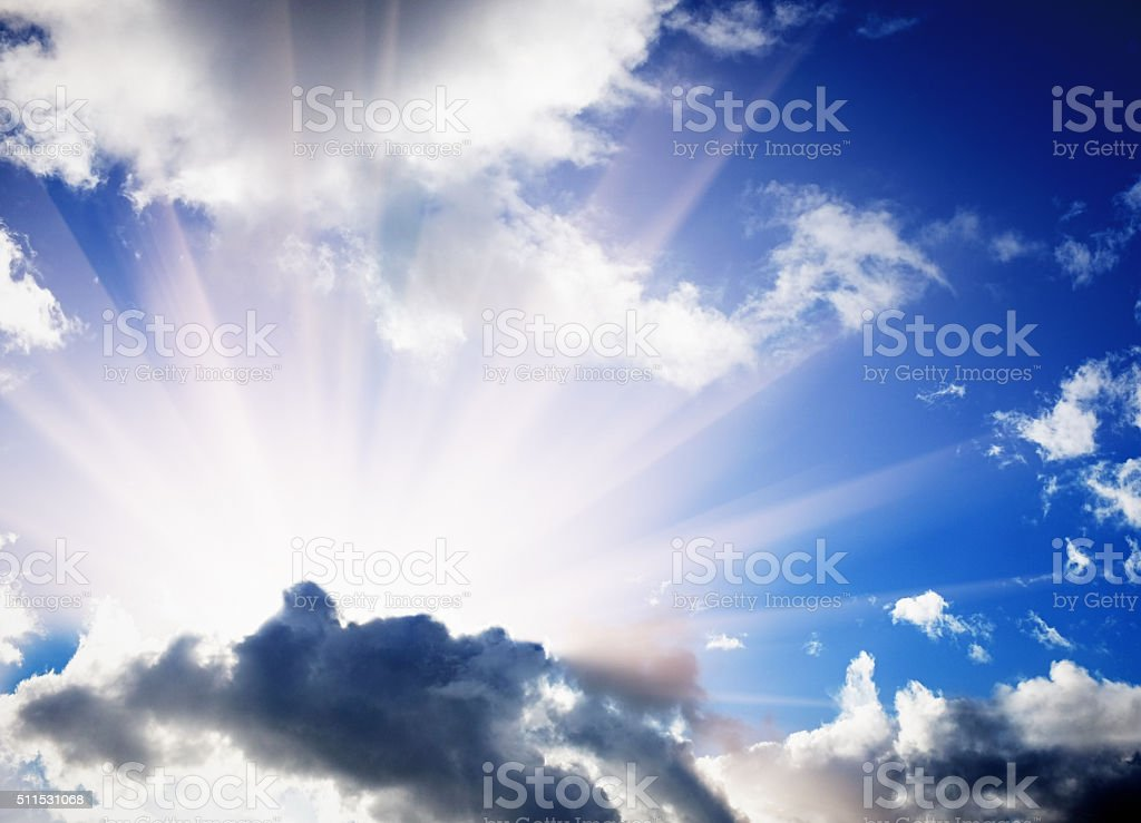The silver lining that's behind every cloud shines through stock photo