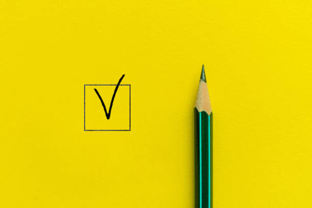 the simple minimalism concept of the pen and the checkbox on the color background stock photo
