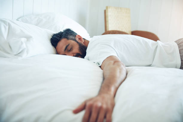 The simple pleasure of sleep Shot of a mature man lying on his bed and sleeping bachelor stock pictures, royalty-free photos & images