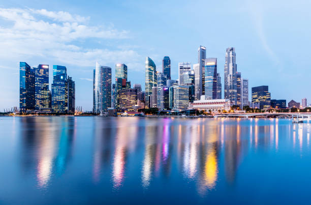 the singapore downtown and marina bay business district skyline at twilight - singapore stock photos and pictures