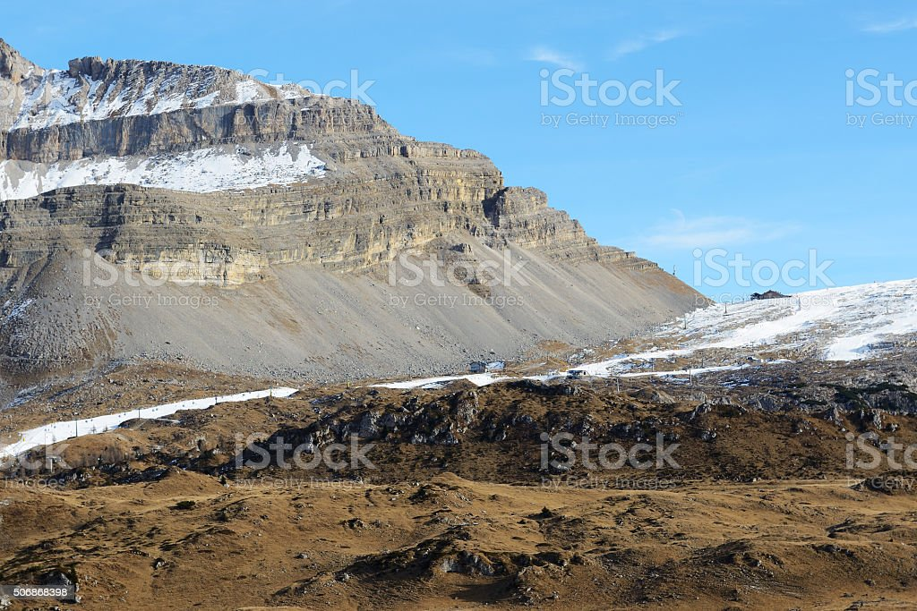 The ski slope with a view on Dolomiti mountains stock photo