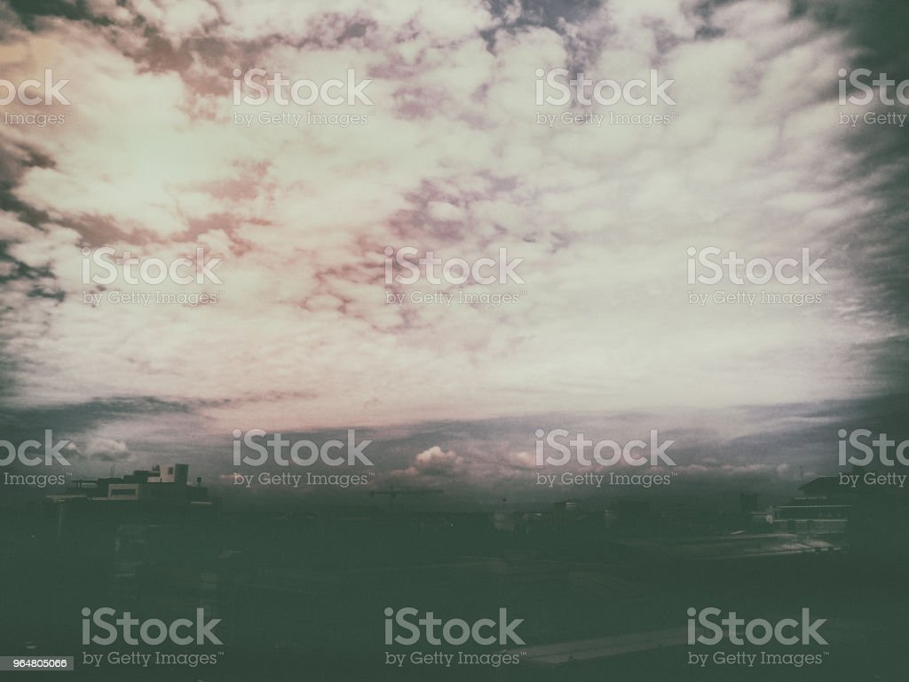 The sky background with smoky waving cloud,in classic old film design,black and white tone,vintage and art style,grainy film style,feel like oil painting wallpaper royalty-free stock photo