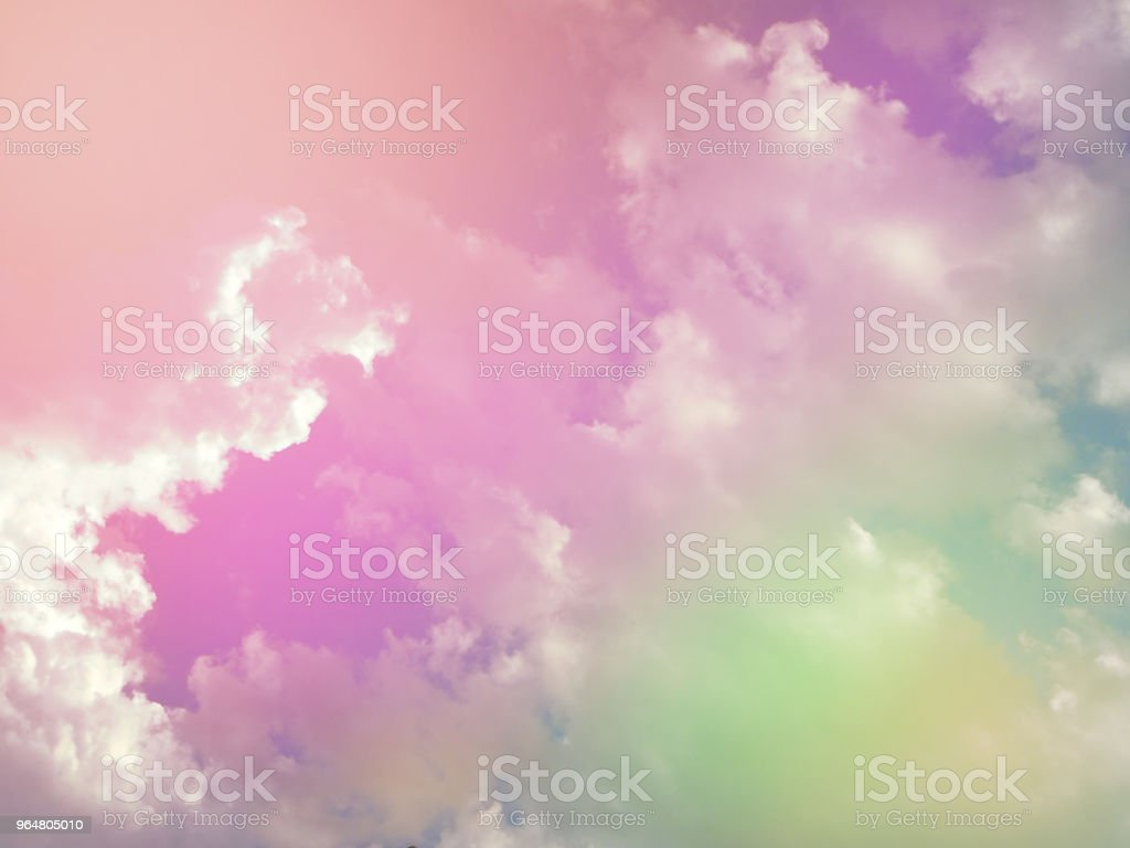 The sky background with tiny cloud,in pastel soft tone,abstract art design,warm light tone,blurry light around,beauty by nature. royalty-free stock photo