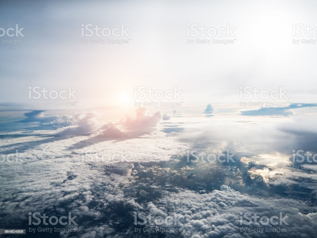 The sky bakground in Morning time,reflection of sunlight is shining to smoky waving cloud,beautiful top view,beauty by nature. royalty-free stock photo