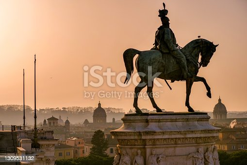 The light of the sunset illuminates the sky of Rome and the silhouette of the Altare della Patria. The Altar della Patria or Vittoriano is the Italian National Monument built between the Capitoline Hill (Campidoglio) and Piazza Venezia in 1885 in honor of the first king of Italy, Victor Emmanuel II (equestrian statue in the photo). Inside is the monument to the Unknown Soldier, the National Memorial dedicated to all the Italian soldiers who died in the war. The Altare della Patria is the setting for all Italian official celebrations, in particular the National Day of the Republic on 2 June and the Liberation Day on 25 April. Image in High Definition format.