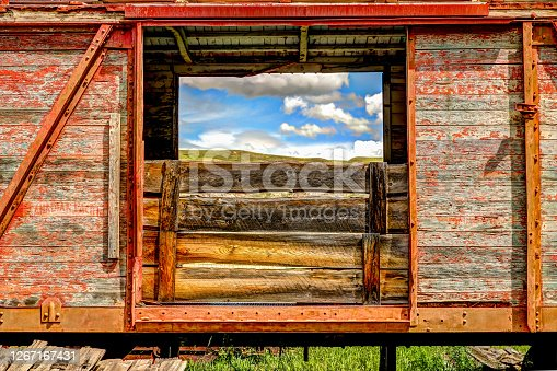 The sky framed by the open doors of a railroad box car in East Coulee Alberta