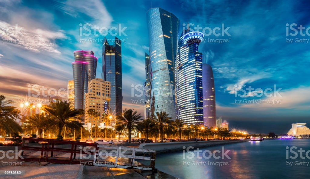 The skyline of Doha city center after sunset, Qatar stock photo