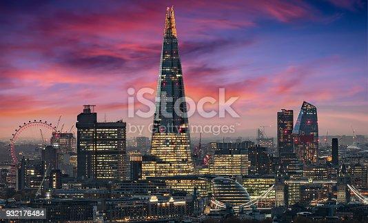 The illuminated skyline of London, United Kingdom, during an intense sunset