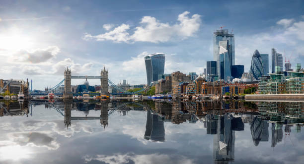 The skyline of London with reflections in the water, United Kingdom stock photo