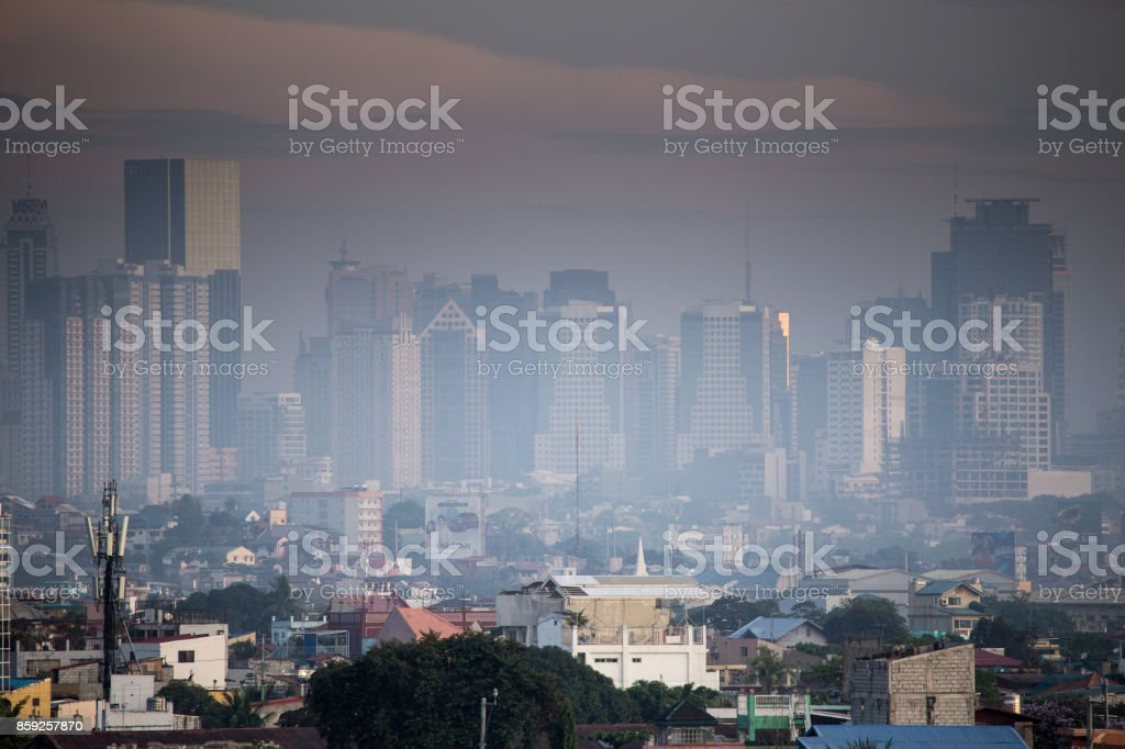 The skyline of manila during sunrise. Smog over the city. stock photo