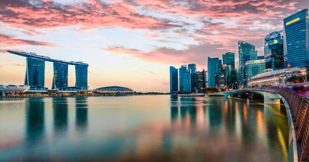 The skyline of Singapore at sunset stock photo