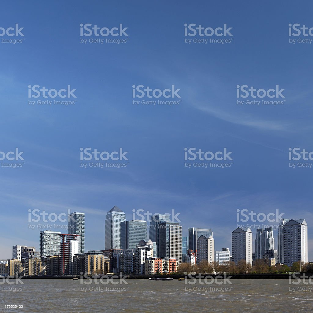 the skyscrapers of Canary Wharf in London and River Thames royalty-free stock photo