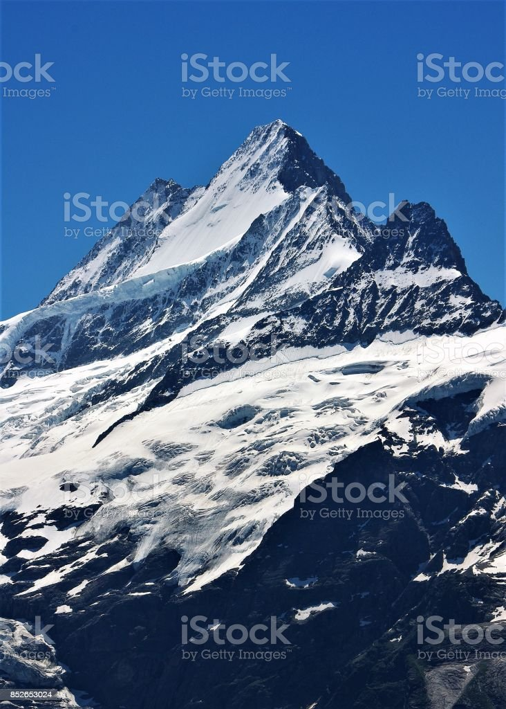 The Slopes and Summit of the Schreckhorn in the high peaks of the Bernese Oberland, Switzerland stock photo