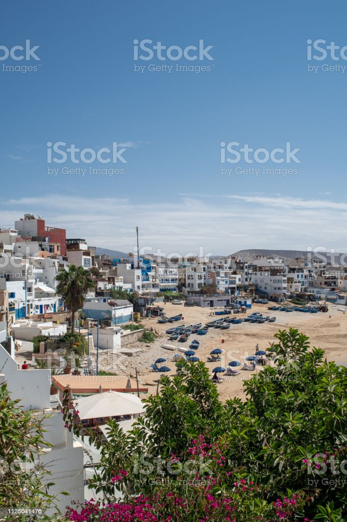 The small and sandy beach of Taghazout, Morocco stock photo