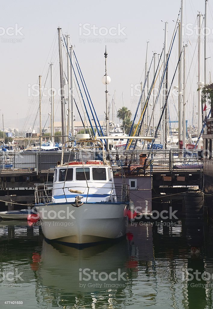 The small boat on a Larnaca quay background royalty-free stock photo