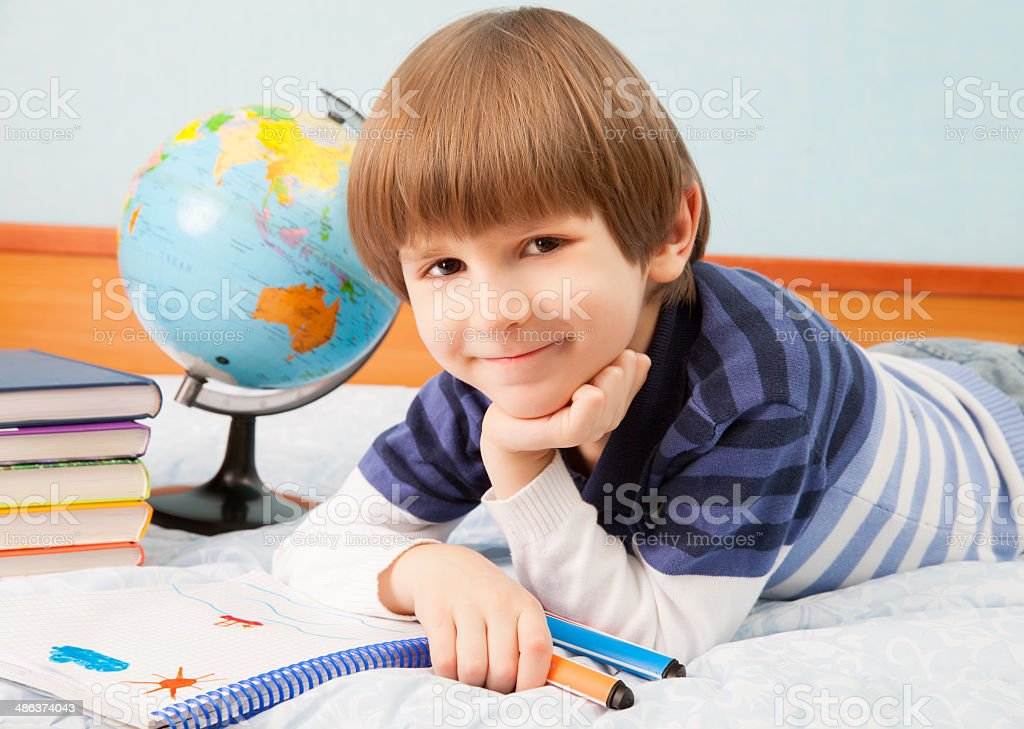 The small boy with notebook royalty-free stock photo