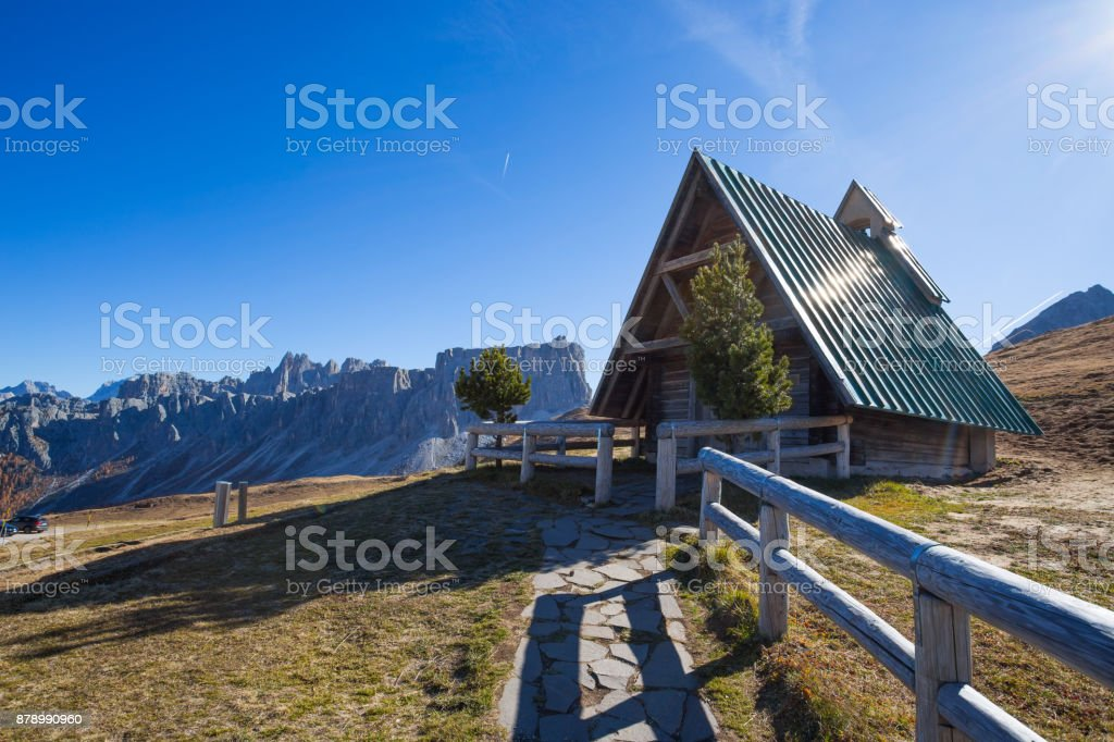 The small church at Giau pass, an alpine Dolomites pass at 2236 metres in Belluno province that connects the villages of Colle Santa Lucia and Selva di Cadore with Cortina d'Ampezzo. stock photo