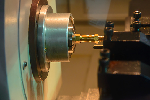 The Small Cnc Lathe Cutting The Brass Shaft Stock Photo & More