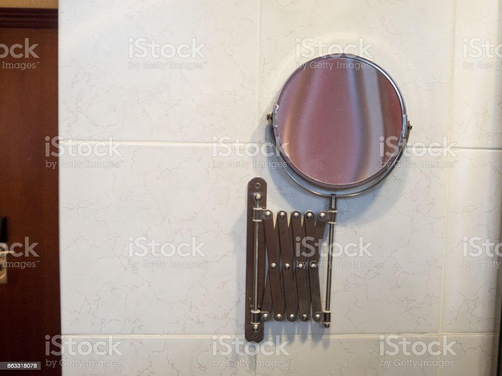 The small mirror in bathroom. stock photo