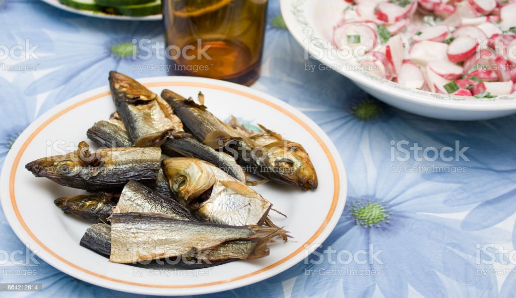 The small pieces of smoked fish on a platter royalty-free stock photo
