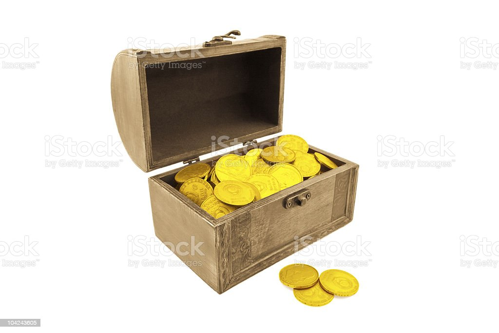 The small wooden trunk with golden coins royalty-free stock photo