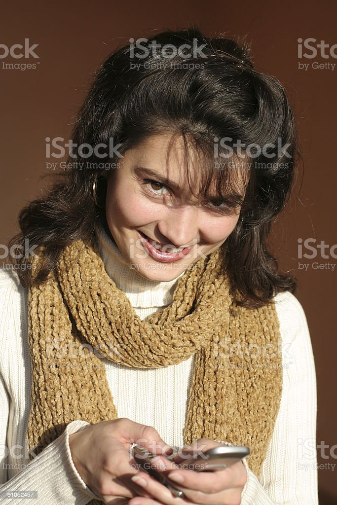 The smiling Girl reads SMS message on mobile telephone. royalty-free stock photo