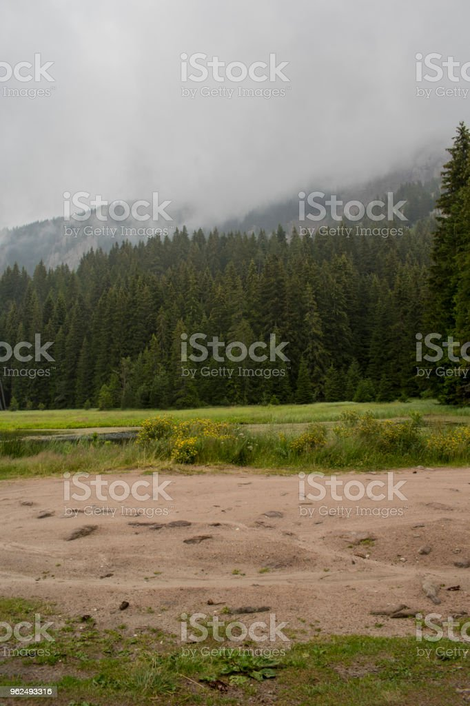 The Smolyan lakes are scattered on the left slope of the valley of the Black River, from the Orpheus rocks and peak Snezhanka to the town of Smolyan,formed in the lower decreases of a large landslide. - Royalty-free Autumn Stock Photo