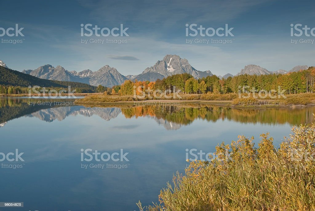 Tetons and Fall Colors Reflected in the Snake River royalty-free stock photo