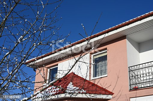 istock the snow on the roof of a private house melts in the sun 1271602497