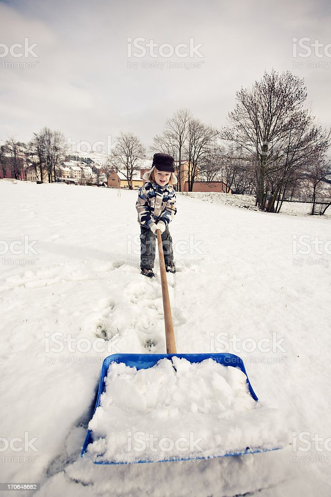 The Snow Shoveler royalty-free stock photo