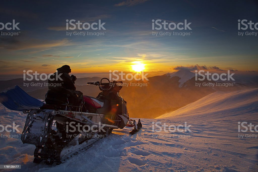 The snowmobile on a beautiful winter landscape stock photo