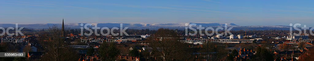 The snowy Black Mountains towering over Hereford, England stock photo