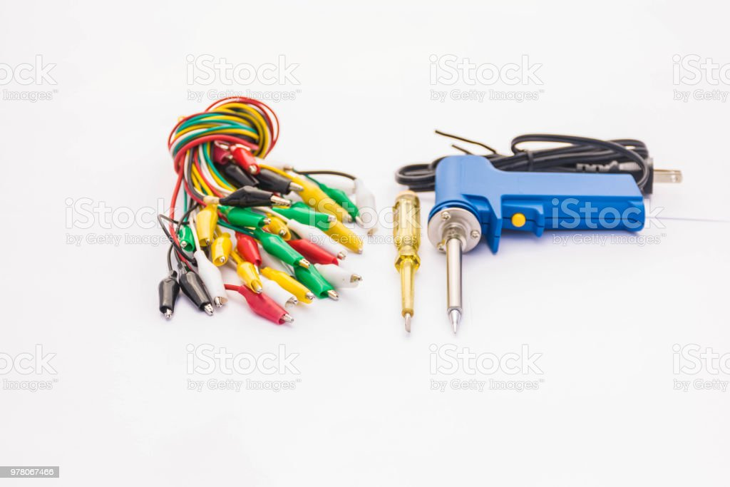 The soft blurred and soft focus of multicolor tweezers, electric screwdriver test lamp, soldering equipment, accessory, spare parts, for electronics and electrical on the white background. stock photo
