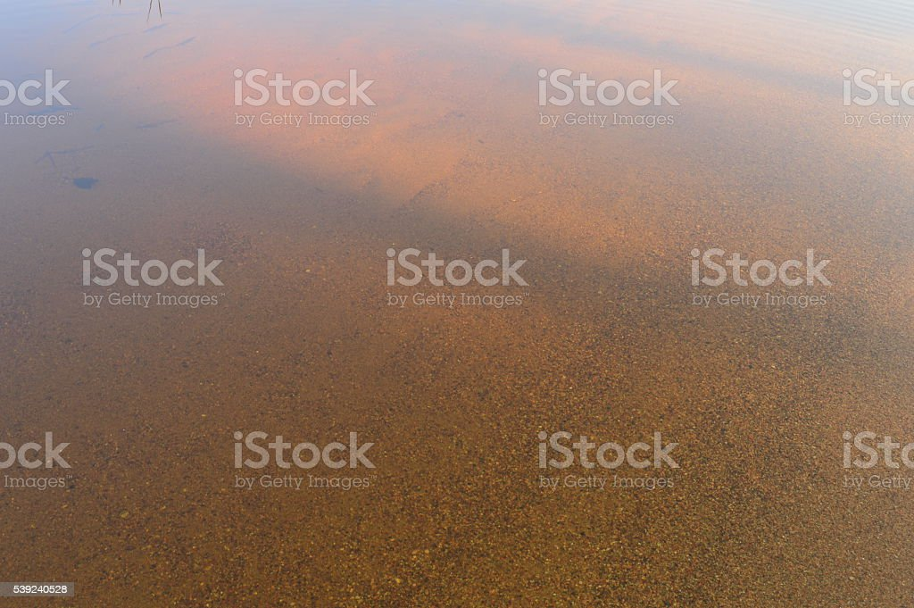 The solar shade on the water surface of a sandy beach royalty-free stock photo
