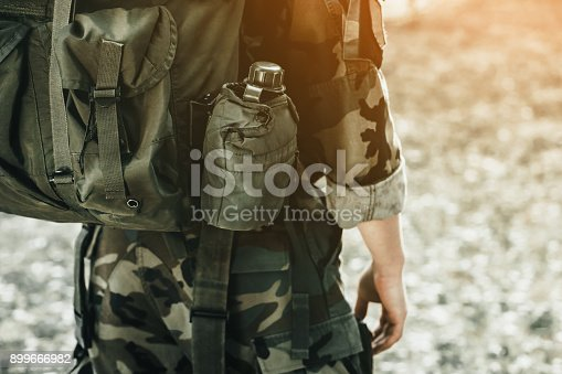 istock The soldier in the performance of tasks in camouflage and protective gloves 899666982