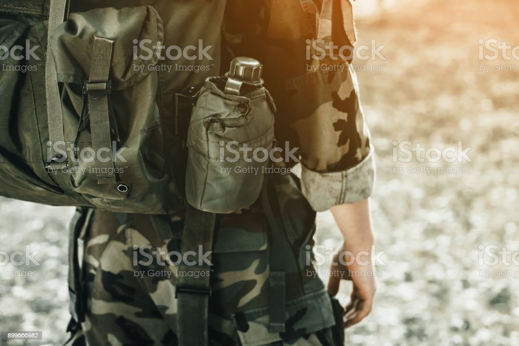 The soldier in the performance of tasks in camouflage and protective gloves stock photo