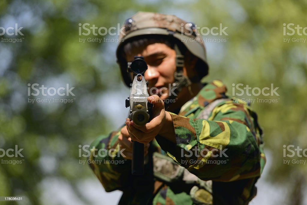 The soldier shooting with camouflage royalty-free stock photo