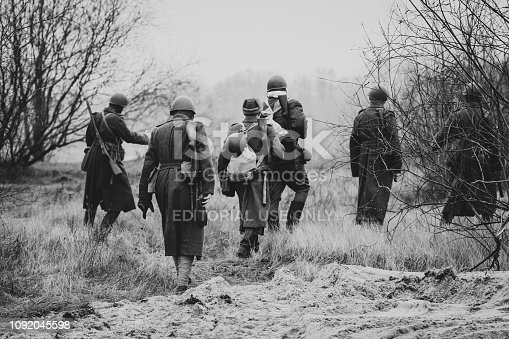 1143756392 istock photo The soldiers of the red army in their overcoats go to the position 1092045598