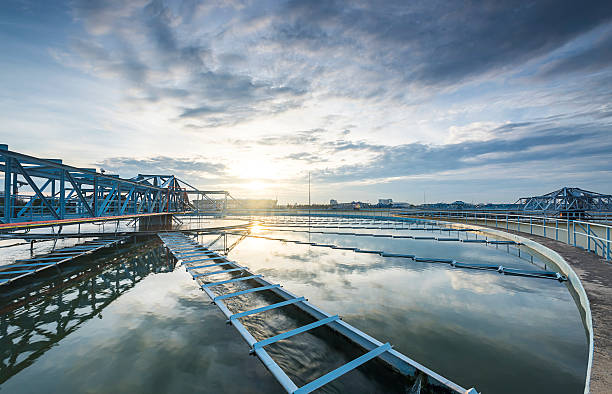 The Solid Contact Clarifier Tank type Sludge Recirculation proce The Solid Contact Clarifier Tank type Sludge Recirculation process in Water Treatment plant with sunrise sewage treatment plant stock pictures, royalty-free photos & images