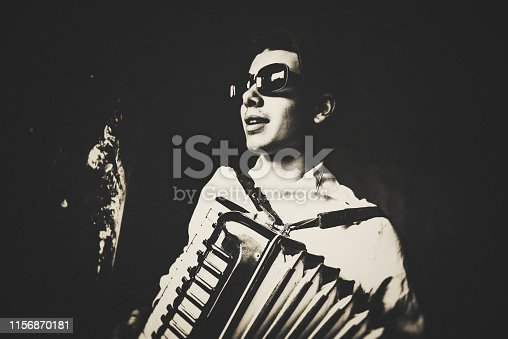 Young man playing his Accordion