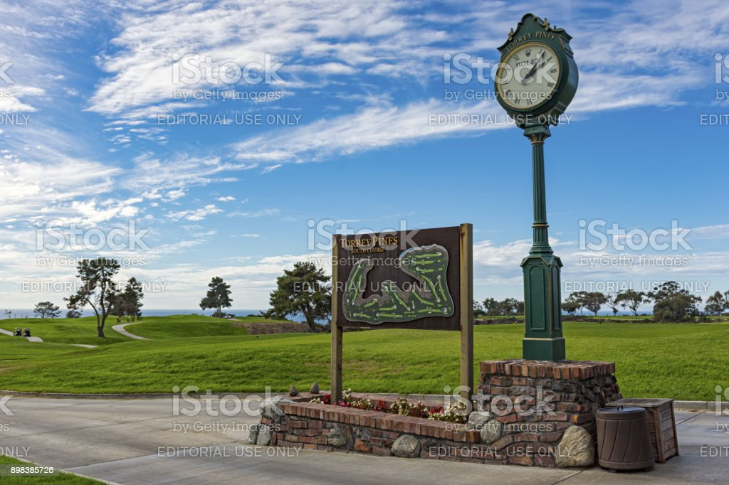 The South Course sign and map beside the Rolex clock on the first tee of Torrey Pines golf course near San Diego. stock photo