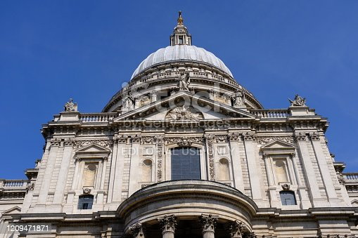 London, England - August 22, 2019: St Paul's Cathedral was built in the 17th-century by Sir Christopher Wren, following the Great Fire of London. It is a magnificent example of English Baroque architecture. St Paul's has played a role in numerous important events in British life, including during World War II when it became a symbol of defiance and fortitude during the Blitz, managing to withstand months of heavy bombing raids.