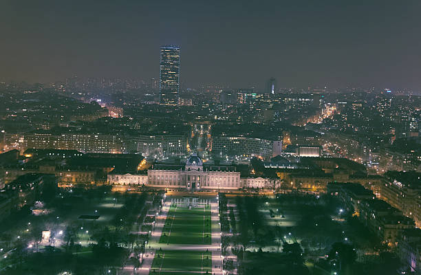 The South of Paris from the Eiffel Tower Taken from the second floor of the Eiffel Tower at night. ecole stock pictures, royalty-free photos & images